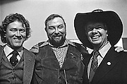 1976 Democratic presidential nominee Jimmy Carter wears the hat of country music performer Charlie Daniels (middle). At left is Carter friend and early supporter, Phil Walden, founder of Capricorn Records of Macon, Georgia. Daniels was playing a fundraiser at Atlanta's historic Fox Theater to benefit Carter's campaign. - To license this image, click on the shopping cart below -