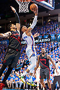 OKLAHOMA CITY, OK - APRIL 21: Russell Westbrook #0 of the Oklahoma City Thunder drives to the basket against Enes Kanter #00 of the Portland Trail Blazers during Round One Game Three of the 2019 NBA Playoffs on April 21, 2019 at Chesapeake Energy Arena in Oklahoma City, Oklahoma  NOTE TO USER: User expressly acknowledges and agrees that, by downloading and or using this photograph, User is consenting to the terms and conditions of the Getty Images License Agreement.  The Trail Blazers defeated the Thunder 111-98.  (Photo by Wesley Hitt/Getty Images) *** Local Caption *** Russell Westbrook; Enes Kanter
