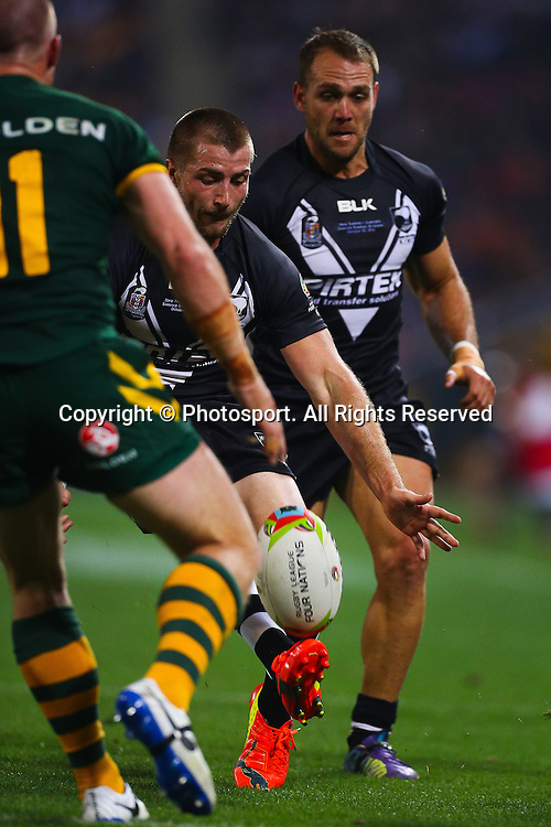 Kieran Foran kicks ahead during the Four Nations test match between Australia and New Zealand at Suncorp Stadium,  Brisbane Australia on October 25, 2014.