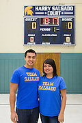 Siblings Teresa Salgado-Ellis and Jeremy Salgado pose for a photo during the Harry Salgado scoreboard dedication ceremony at Sierramont Middle School in San Jose, California, on January 8, 2015. (Stan Olszewski/SOSKIphoto)