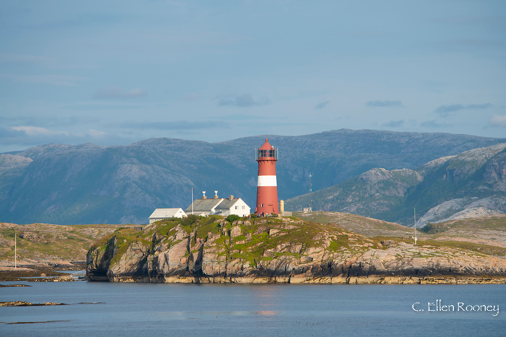 The red and white Bulholmrasa lighthouse on the northwest coast of Norway.