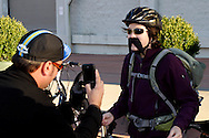 Andy Williamson, captain of team Mo Fro (left) takes a photo before his group of cyclists begins the Dayton Movember Mustache Ride to benefit men's cancer awareness and research through downtown Dayton on First Friday, November 4, 2011.
