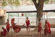 Monks playing football at monestary, Mandalay, Burma