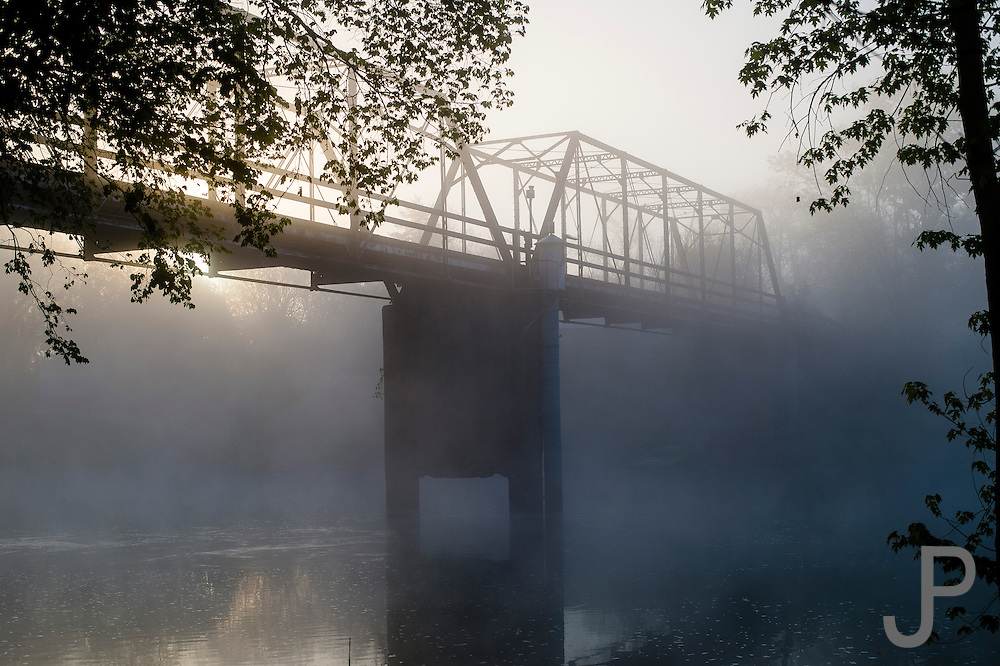 Morning fog envelopes a closed bridge across the Illinois River just east of Tahlequah, OK.
