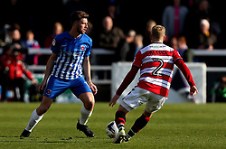 Lewis Hawkins of Hartlepool United takes on Craig Alcock of Doncaster Rovers - Mandatory by-line: Robbie Stephenson/JMP - 06/05/2017 - FOOTBALL - The Northern Gas and Power Stadium (Victoria Park) - Hartlepool, England - Hartlepool United v Doncaster Rovers - Sky Bet League Two