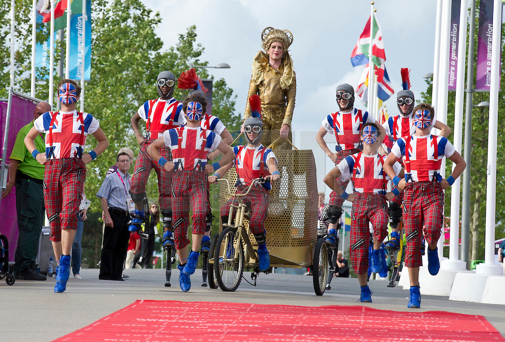 © Licensed to London News Pictures. 28/08/2012, Paralympic Athletes Village, Olympic Park, London. The 'Queen of the Olympics' rides into the Olympic village to welcome the Team GB Paralympic athletes ahead of the Paralympic Games, which is due to start on the 29 Aug 12.   Photo credit : Alison Baskerville/LNP