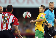 London - Tuesday, August 18th, 2009: Wes Hoolahan of Norwich City takes on Brentford's Mark Philips during the Coca Cola League One match at Griffin Park, London. (Pic by Chris Ratcliffe/Focus Images)