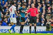 Lee Mason (Referee) talking with Jurgen Locadia (Brighton) prior to awarding him a yellow card during the FA Cup fourth round match between Brighton and Hove Albion and West Bromwich Albion at the American Express Community Stadium, Brighton and Hove, England on 26 January 2019.