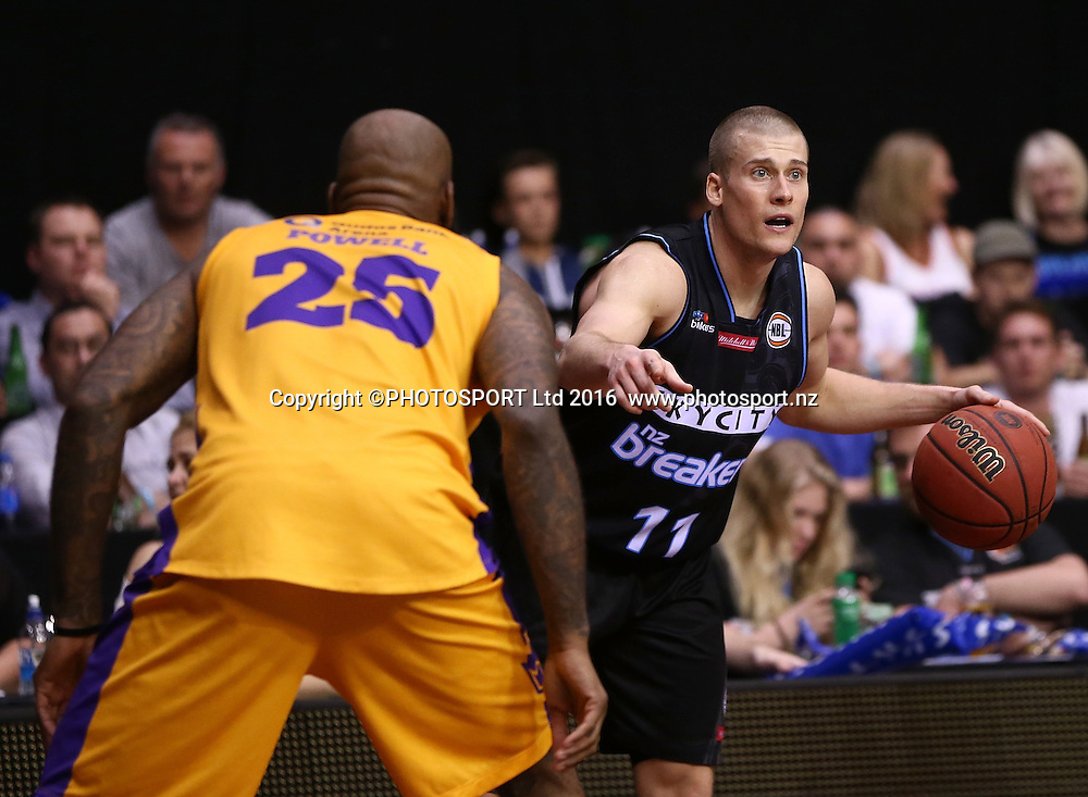Breakers` Ben Woodside is challenged by Kings` Josh Powell in the Round 3 ANBL Basketball Match, New Zealand Breakers v Sydney Kings, North Shore Events Centre, Auckland, New Zealand, Thursday, October 20, 2016. Copyright photo: David Rowland / www.photosport.nz