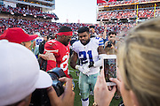 San Francisco 49ers running back Carlos Hyde (28) talks with Dallas Cowboys running back Ezekiel Elliott (21) after the game at Levis Stadium in Santa Clara, Calif., on October 2, 2016. (Stan Olszewski/Special to S.F. Examiner)