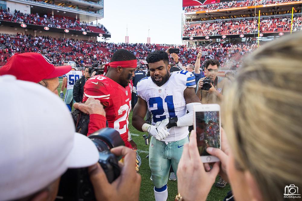 San Francisco 49ers running back Carlos Hyde (28) talks with Dallas Cowboys running back Ezekiel Elliott (21) after the game at Levis Stadium in Santa Clara, Calif., on October 2, 2016. (Stan Olszewski/Special to S.F. Examiner)
