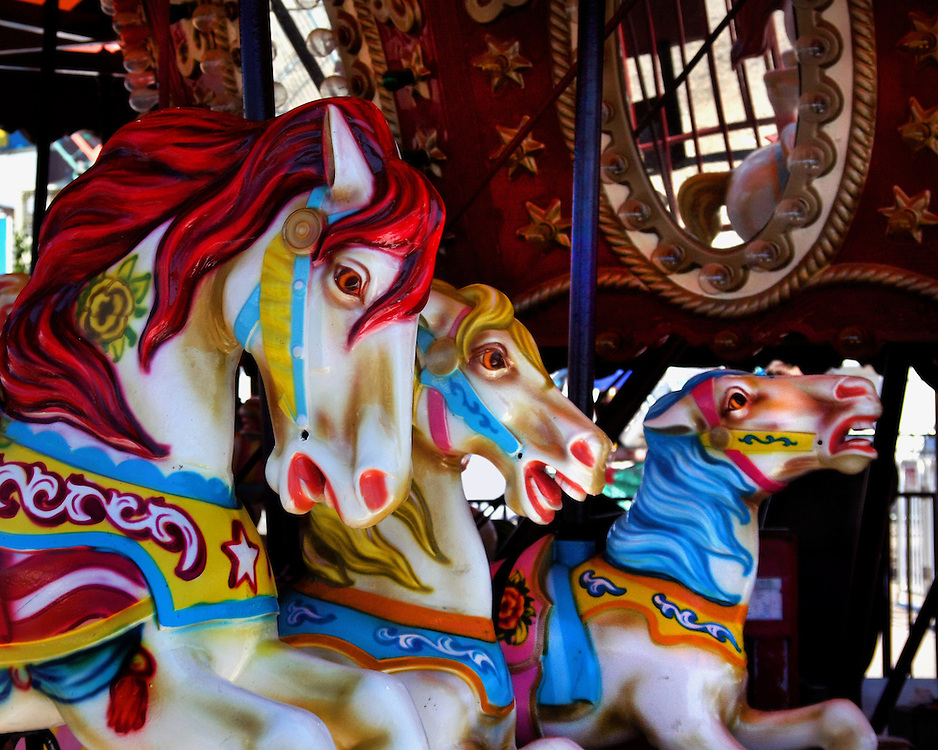 Wooden horse's on a kid's carousel.