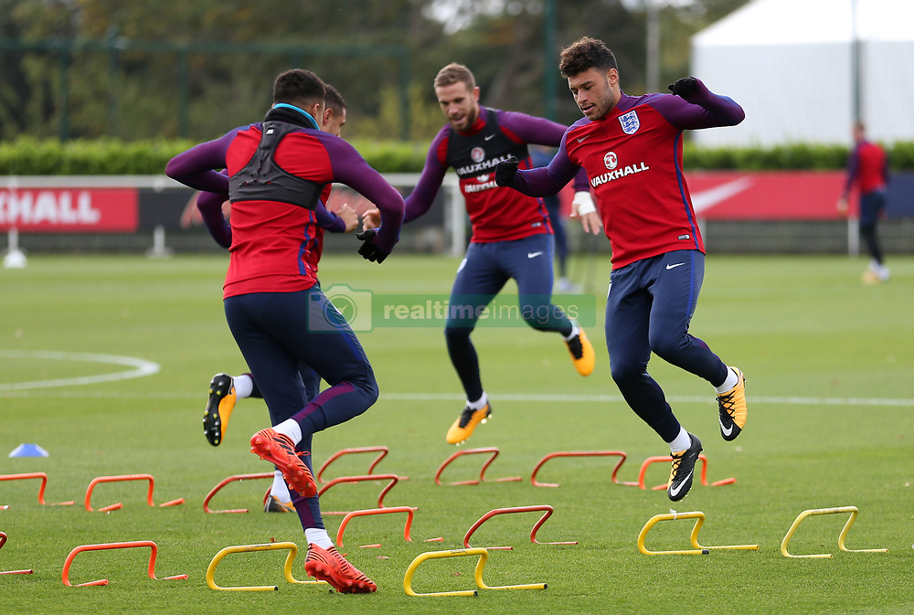 England's Alex Oxlade-Chamberlain (right) during the training session at Enfield Training Centre, London.