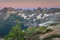 Twilight view of rugged overlapping peaks and ridges of the North Cascades. From Cutthoat Pass looking towards Liberty Bell Mountain.
