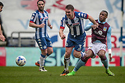 Jake Buxton (Captain) (Wigan Athletic) gets past the challenge of Jonathan Kodjia (Aston Villa) during the EFL Sky Bet Championship match between Wigan Athletic and Aston Villa at the DW Stadium, Wigan, England on 18 March 2017. Photo by Mark P Doherty.