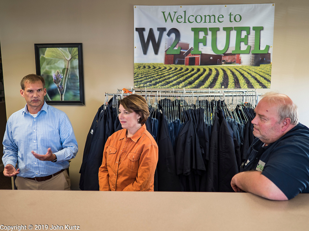 18 OCTOBER 2019 - CRAWFORDSVILLE, IOWA: US Senator AMY KLOBUCHAR (D-MN) talks to DANA VARNEY, the remaining worker at W2 Fuel, a biodiesel refinery that used soybeans to make biodiesel. W2 Fuel closed about a month ago because of low demand for biofuels, brought on by the number of biofuels waivers the US EPA has given to petroleum refineries. Sen. Klobuchar is on barnstorming bus tour of southeast Iowa this weekend. She is campaigning to be the Democratic nominee for the US Presidency. In addition to campaign meet and greet events, she stopped at a biofuels plant to learn about the difficulties farmers and biofuels producers face because of the trade war with China. Iowa holds the first selection event of the Presidential election cycle. The Iowa caucuses are Feb. 3, 2020.        PHOTO BY JACK KURTZ