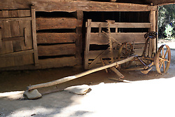 08 October 2016:   Great Smokey Mountains National Park an old hay cutting implement that was horse drawn is shown in the blacksmith shop at Cades Cove Historic Area Visitors Center in Blount County Tennessee.  Cades Cove is within the Great Smoky Mountains National Park