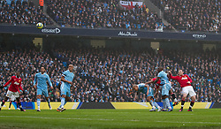 MANCHESTER, ENGLAND - Sunday, January 8, 2012: Manchester United's Wayne Rooney scores the first goal against Manchester City during the FA Cup 3rd Round match at the City of Manchester Stadium. (Pic by Vegard Grott/Propaganda)