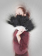 Digitally enhanced image of a young Gothic teen hiding behind a black feathered fan - Model Release Available