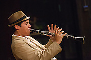 "Oscar Pangilinan of San Jose State University's School of Music and Dance's Thursday Morning Revival plays the clarinet during a performance of ""Bourbon Street Parade"" during Humanities & Arts Day Student Showcase at San Jose State University's Student Union Barrett Ballroom in San Jose, California, on October 25, 2013. (Stan Olszewski/SOSKIphoto)"