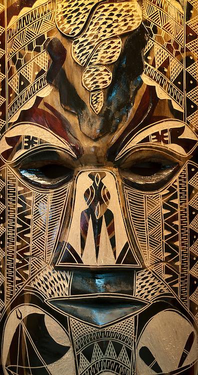 Carved wooden mask at Jack's Handicrafts; Nadi, Viti Levu Island, Fiji.