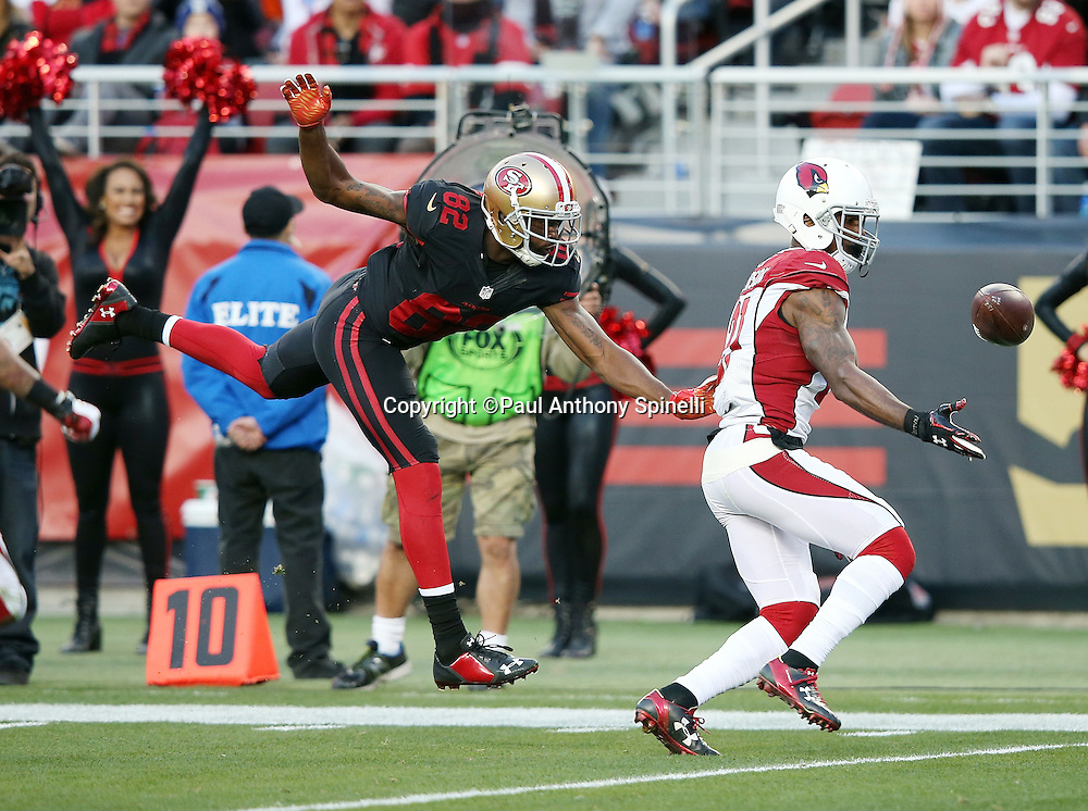 San Francisco 49ers wide receiver Torrey Smith (82) leaps while trying to catch a late fourth quarter pass broken up by Arizona Cardinals cornerback Patrick Peterson (21) during the 2015 week 12 regular season NFL football game against the San Francisco 49ers on Sunday, Nov. 29, 2015 in Santa Clara, Calif. The Cardinals won the game 19-13. (©Paul Anthony Spinelli)