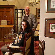 Robert Rossi, left, and Julia Vosler pose for a portrait at Home Design Outlet of Leland. (Jason A. Frizzelle)
