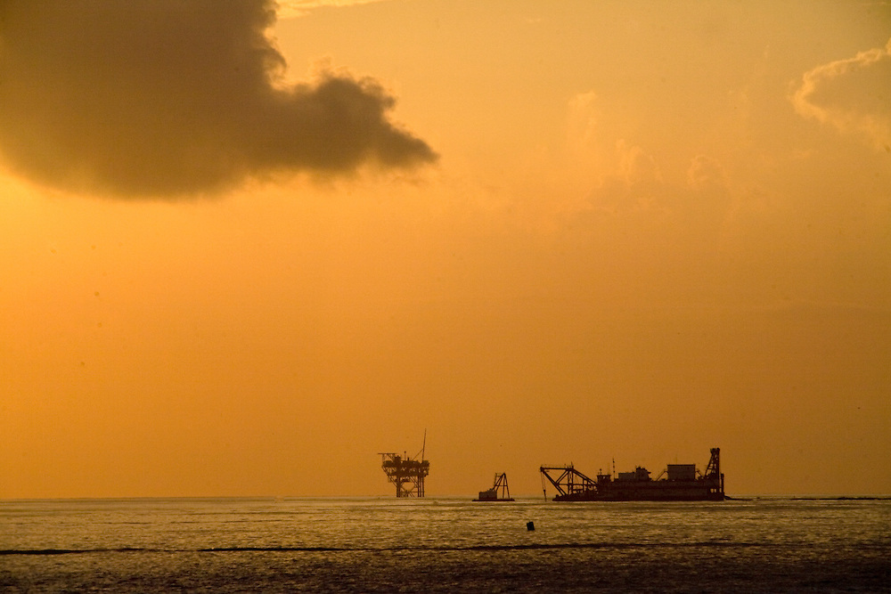 An oil well is seen at daybreak in Grand Isle, LA on June 24, 2010 where oil from the B.P. oil spill has reached land.