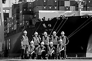 Members of the United State Coast Guard Marine Safety Office pose for a photo on the Garden City Terminal at the Port of Savannah, Tuesday, Aug. 23, 2016, in Garden City, Ga.  (GPA Photo/Stephen B. Morton)