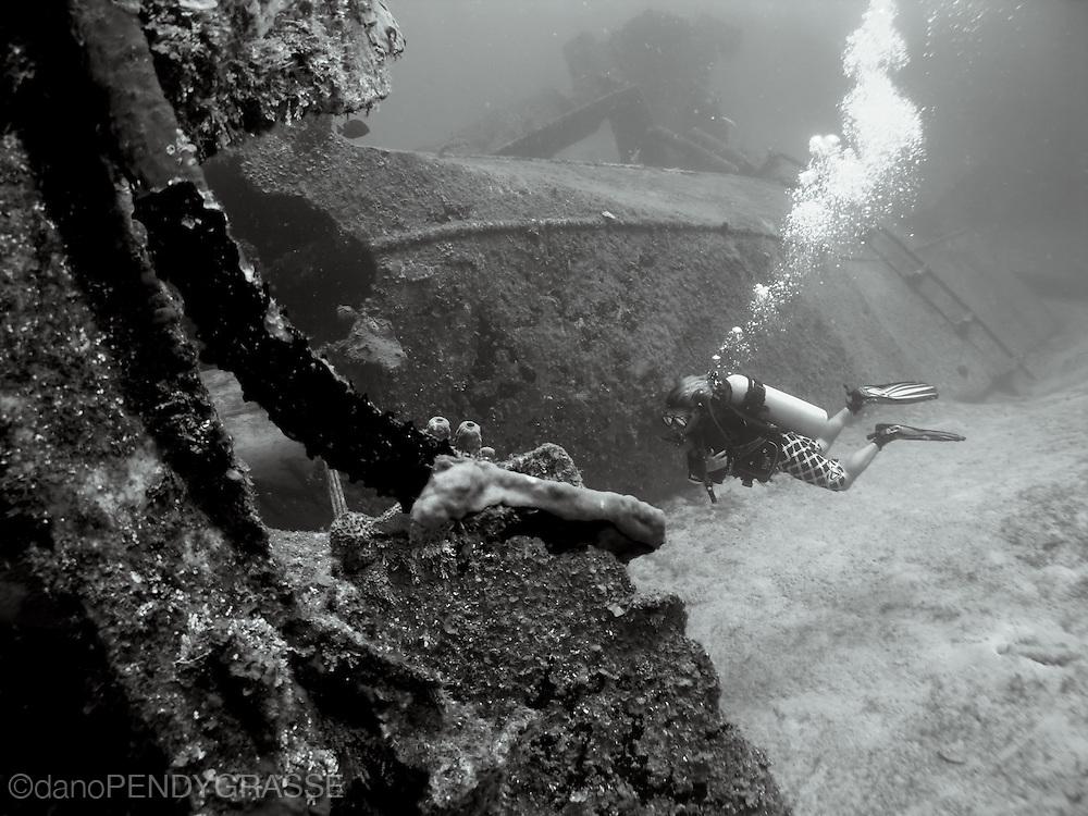 A scuba diver glides by the wreck of the El Aguila, in Roatan, Honduras.