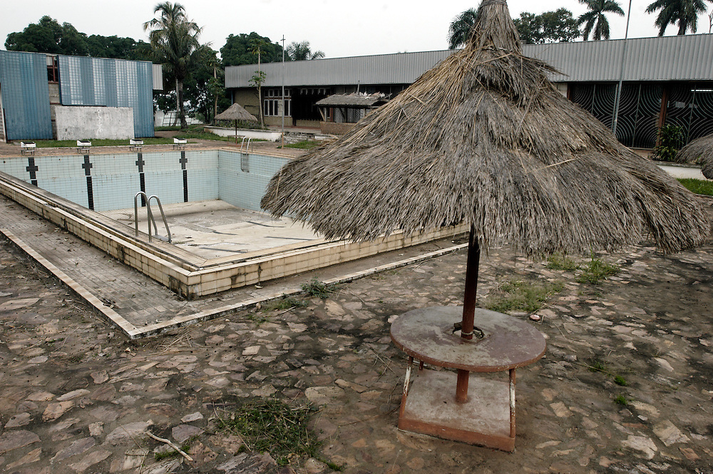 The pool area and garden of the Hotel Nzekele which was built by Mobutu Sese Seko, and is still owned by his family, in his native village in Equateur province. .Gbadolite, DR Congo. 16/03/2009.Photo © J.B. Russell