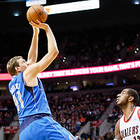 07 December 2013: Dallas Mavericks power forward Dirk Nowitzki (41) takes a jumpshot over Portland Trail Blazers power forward LaMarcus Aldridge (12) during the Dallas Mavericks 108-106 victory over the Portland Trail Blazers at the Moda Center, Portland, Oregon, USA.