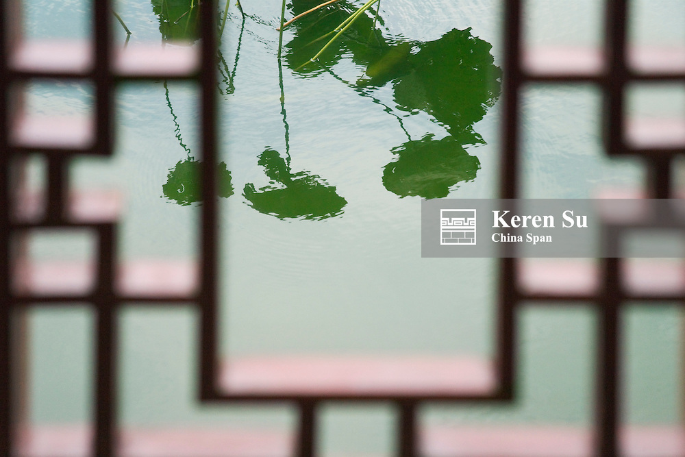 View of lotus pond through latticed window of traditional architecture, Shanghai, China