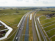 Nederland, Zuid-Holland, Gemeente Alkemade, 20-02-2012; infrastructuur bundel bestaande uit autosnelweg A4 en het hogesnelheidspoor HSL-Zuid (re) doorkruist het veenweidelandschap tussen Roelofarendsveen en Rijpwetering. .Infrastructure bundle consisting of A4 motorway and the high-speed (r) crosses the bog meadows area between Roelofarendsveen and Rijpwetering..luchtfoto (toeslag), aerial photo (additional fee required).copyright foto/photo Siebe Swart
