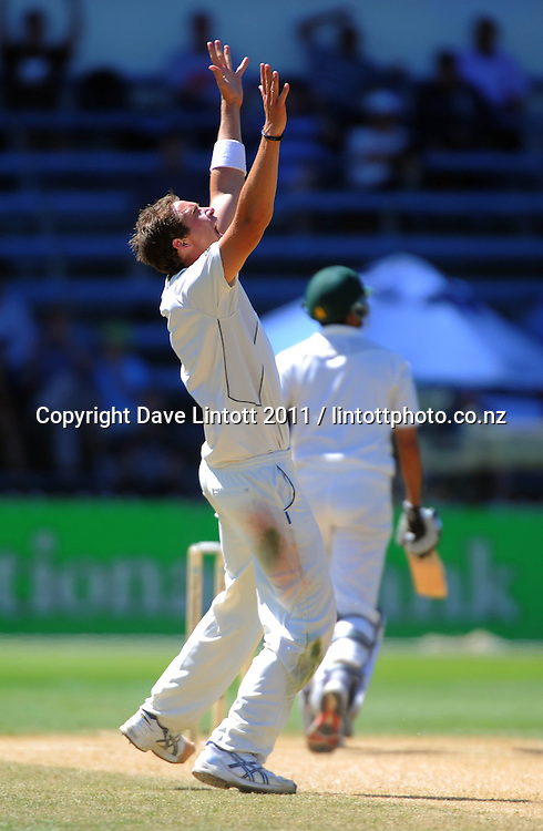 NZ's Tim Southee celebrates the dismissal of Younis Khan for 81. 2nd cricket test match - New Zealand Black Caps v Pakistan, day five at the Basin Reserve, Wellington, New Zealand on Wednesday, 19 January 2011. Photo: Dave Lintott / photosport.co.nz