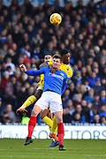 Oliver Hawkins (9) of Portsmouth battles for possession with Paul Kalambayi (30) of AFC Wimbledon during the EFL Sky Bet League 1 match between Portsmouth and AFC Wimbledon at Fratton Park, Portsmouth, England on 1 January 2019.