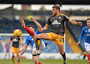 Portsmouth defender Enda Stevens and Cambridge United Forward Ben Williamson during the Sky Bet League 2 match between Portsmouth and Cambridge United at Fratton Park, Portsmouth, England on 27 February 2016. Photo by Adam Rivers.