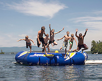 A group of local youngsters enjoy summer time fun on Lake Winnipesaukee at Smith Cove Friday afternoon.  (Karen Bobotas/for the Laconia Daily Sun)