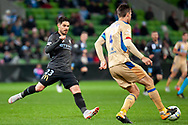 Melbourne City forward Bruno Fornaroli (23) runs for the ball against Newcastle Jets defender Nigel Boogaard (4) at the FFA Cup Round 16 soccer match between Melbourne City FC v Newcastle Jets at AAMI Park in Melbourne.