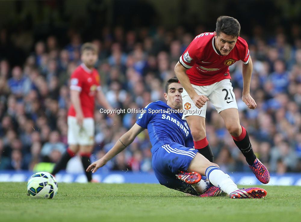 18 April 2015 - Barclays Premier League - Chelsea v Manchester United - Oscar of Chelsea puts a sliding tackle on Ander Herrera of United.<br /> <br /> <br /> Photo: Ryan Smyth/Offside