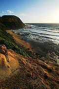 View of Susan Gilmore Beach at sunrise<br /> , Newcastle, Australia.<br /> Part of Australia's rugged East Coast, this beach got it's name from the sailing ship that sunk there in the 19th Century.