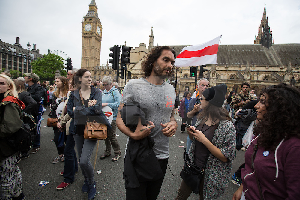 © Licensed to London News Pictures . 20/06/2015 . London , UK . RUSSELL BRAND arrives in Parliament Square . Tens of thousands of people march from the Bank of England to Parliament , to protest economic austerity in Britain . Photo credit: Joel Goodman/LNP