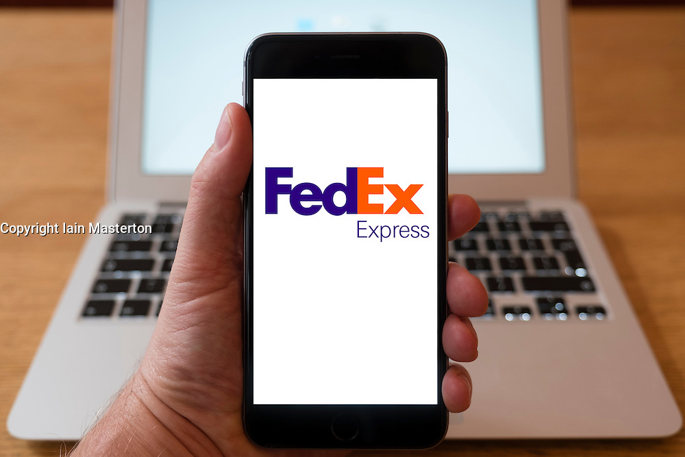 Using iPhone smartphone to display logo of FedEx Express air freight company