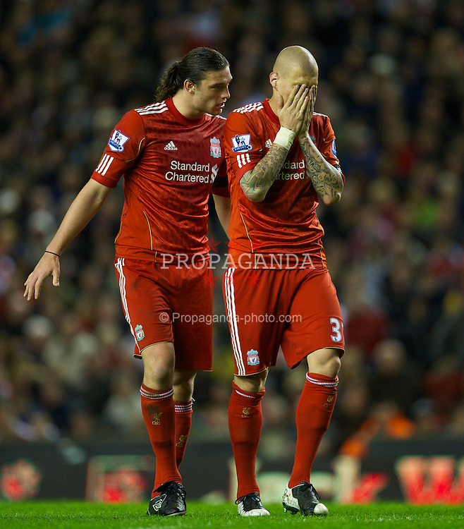LIVERPOOL, ENGLAND - Monday, April 11, 2011: Liverpool's Andy Carroll and Martin Skrtel in action against Manchester City during the Premiership match at Anfield. (Photo by David Rawcliffe/Propaganda)