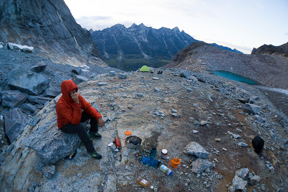 Clint Helander relaxes in camp after a long day in the Arrigetch Peaks. MR, MRA