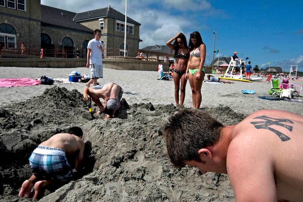 Digging in the sand, Scarborough Beach. Narragansett, RI
