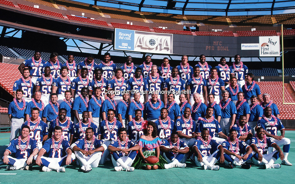 Members of the NFC National Football Conference pose for a team photo on photo day during the week of the 1990 NFL Pro Bowl between the National Football Conference and the American Football Conference on Jan. 30, 1990 in Honolulu. The NFC won the game 27-21. (©Paul Anthony Spinelli)