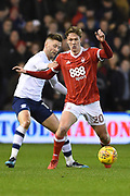 Nottingham Forest midfielder Kieran Dowell (20) battles with Preston North End striker Tom Barkhuizen (29) during the EFL Sky Bet Championship match between Nottingham Forest and Preston North End at the City Ground, Nottingham, England on 30 January 2018. Photo by Jon Hobley.