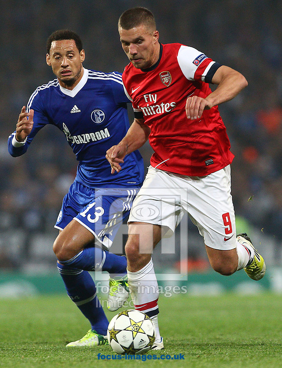 Picture by Paul Terry/Focus Images Ltd +44 7545 642257.24/10/2012.Lukas Podolski of Arsenal and Jermain Jones of FC Schalke during the UEFA Champions League match at the Emirates Stadium, London.
