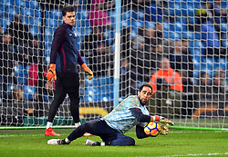 Manchester City goalkeeper Claudio Bravo warms up before the game watched by goalkeeper Ederson
